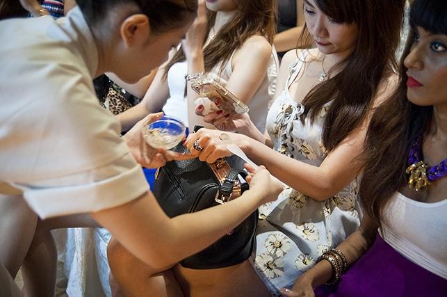 Spa therapist doing hand sampling demo on japanese skincare workshop participant