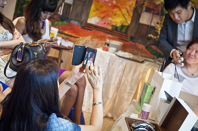 Ikeda Spa japanese skincare workshop participant taking photo using handphone