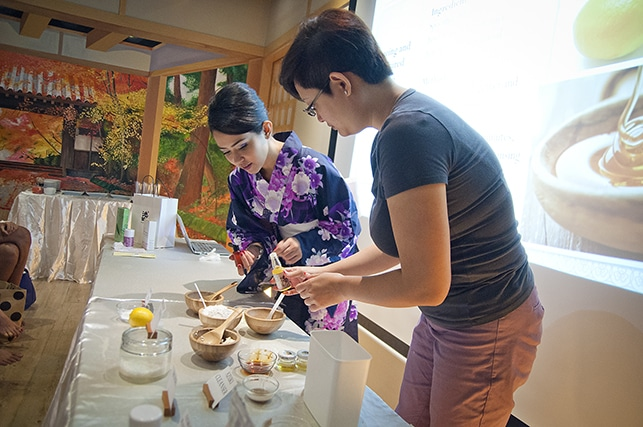 Ikeda Spa trainer showing beauty workshop demostration at Ikeda Spa Prestige